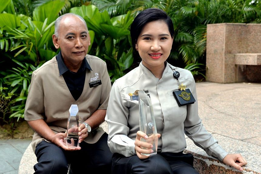 Aviation security officer Nguyen Thi Tuyet Trang (right) won the Service Personality of the Year, while Smarte Carte trolley supervisor Mohammad Noor Abdullah was recognised with an Outstanding Custodial Staff (Bronze) award at Changi Airport's 25th