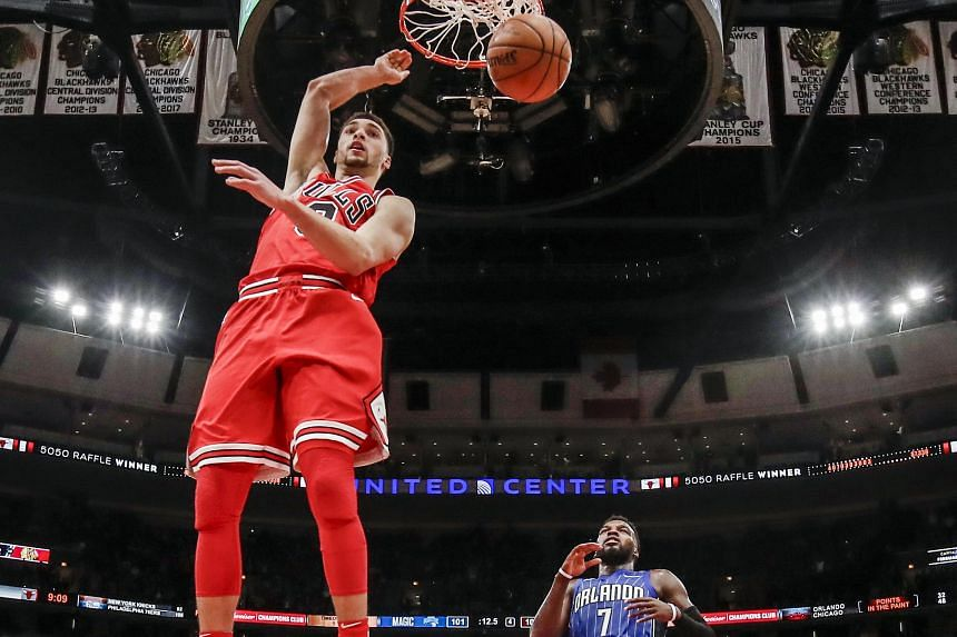 Chicago Bulls guard Zach LaVine (left) scores in front of Orlando Magic guard Shelvin Mack (right) in the second half of the NBA basketball game between the Orlando Magic and the Chicago Bulls at the United Centre in Chicago on Feb 12, 2018.