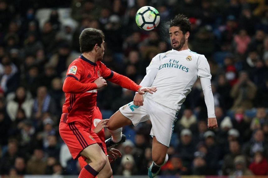 Real Madrid's Isco in action with Real Sociedad's Aritz Elustondo on Feb 10, 2018.