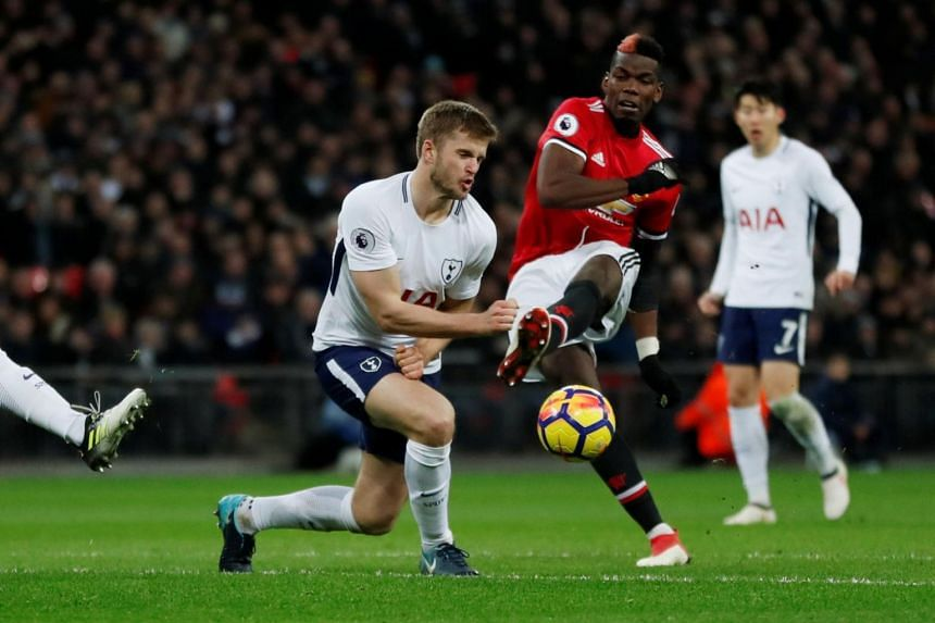 Manchester United's Paul Pogba in action with Tottenham's Eric Dier in an English Premier League match on Jan 31, 2018.