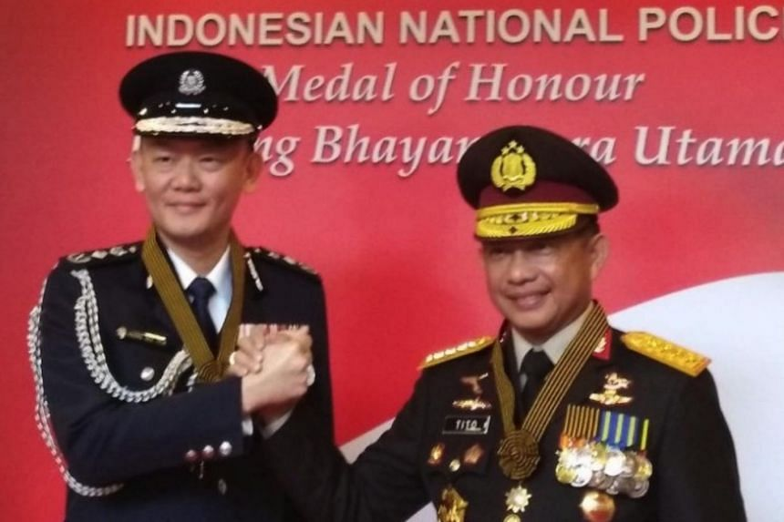 Commissioner of Police Hoong Wee Teck (left) was recognised for his outstanding contributions to the maintenance of regional security.