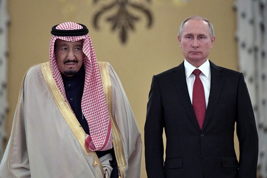 King Salman (left) attending a welcome ceremony ahead of talks in Moscow in October 2017 with President Putin.