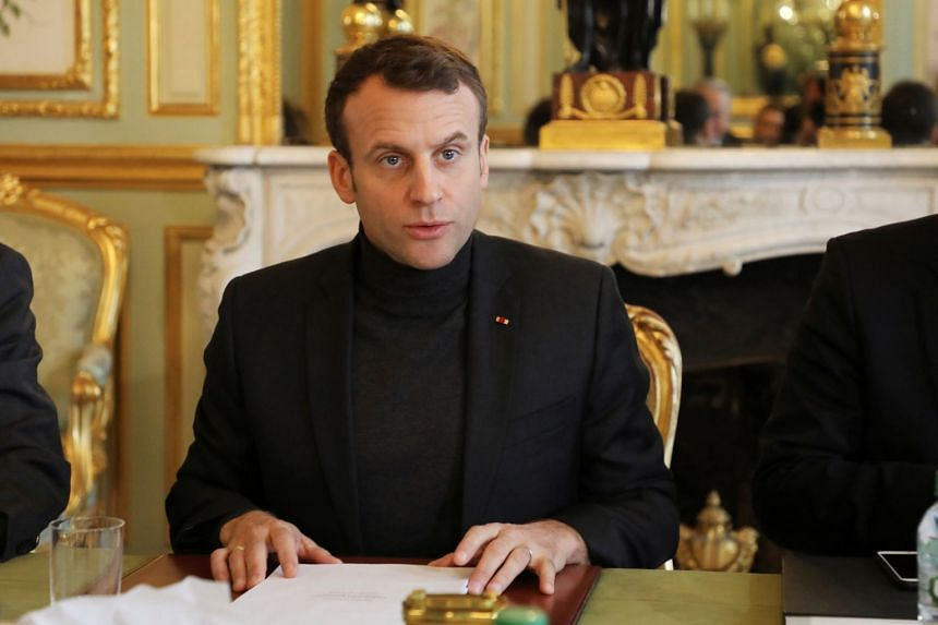 Macron attending a meeting aimed at strenghtening links between France and Russia, Feb 9, 2018.