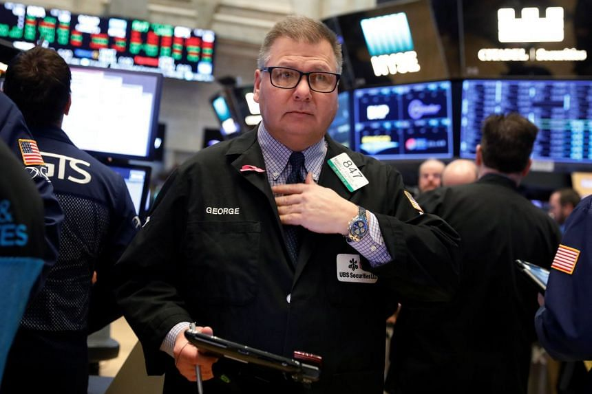 Traders work on the floor of the New York Stock Exchange shortly after the opening bell, Feb 13, 2018.