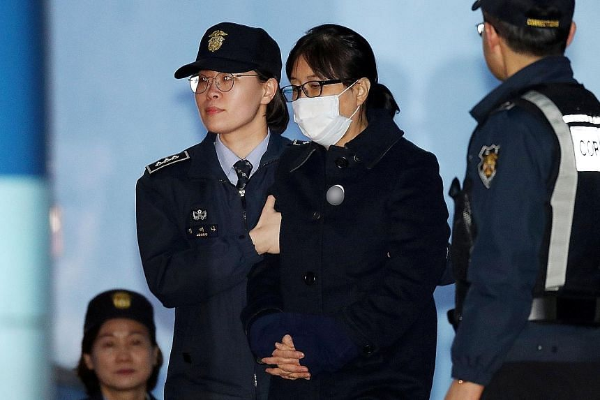 Choi Soon Sil being conveyed to a detention centre yesterday after the Seoul Central District Court found her guilty of abuse of power, bribery and interfering in government business. She had claimed she never sought any personal benefit but attempte