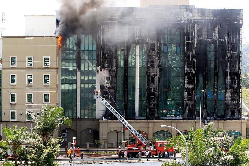 Firefighters dousing the blaze at the Employees Provident Fund (EPF) building in Jalan Gasing, Petaling Jaya, yesterday. Deputy director-general Soiman Jahid of the Fire and Rescue Services Department confirmed that it was the first fire involving fl