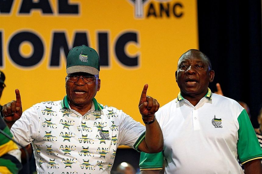South African President Jacob Zuma (left) and ANC leader Cyril Ramaphosa at the party's conference in Johannesburg in December.