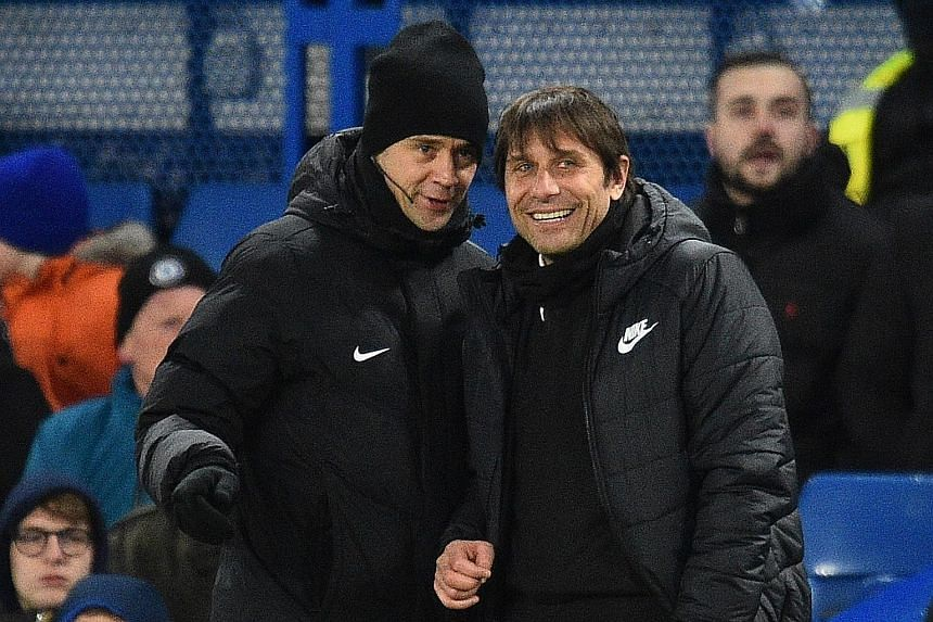 Left: Chelsea's Victor Moses doing a somersault as he celebrates scoring the second against West Brom at Stamford Bridge. Below: Chelsea coach Antonio Conte can afford a smile talking to fourth official Stuart Attwell, with the champions winning for