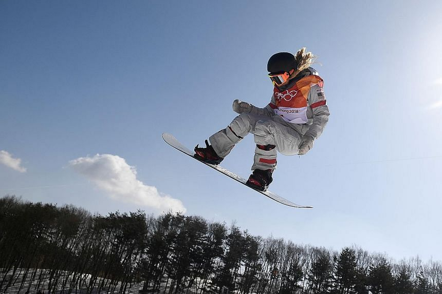 Chloe Kim performing a move during her third run yesterday in the snowboard half-pipe final at the Olympics, winning gold with a near-perfect 98.25. China's Liu Jiayu was second and American Arielle Gold third.