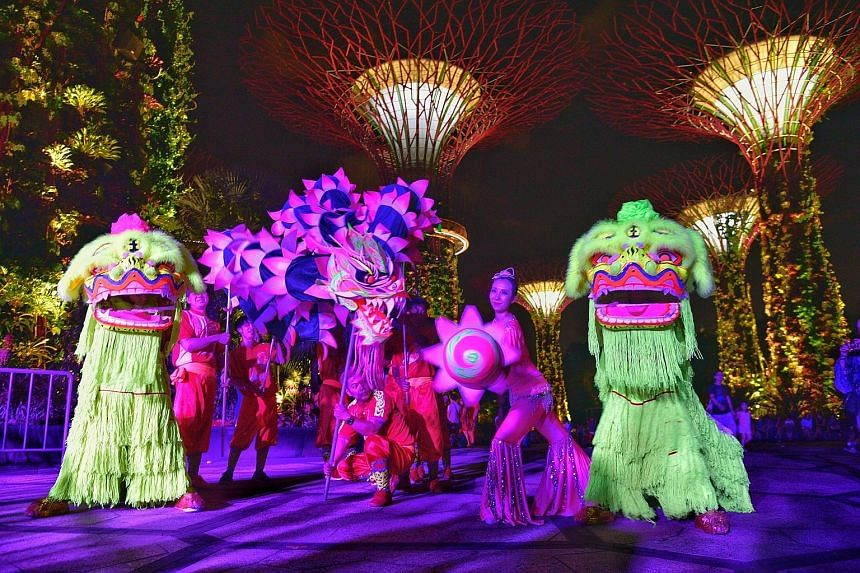 """The traditional lion and dragon dance took on a modern twist at the Gardens by the Bay yesterday, as dancers pranced about the Supertree Grove aglow with ultraviolet light. The performance offered visitors a sneak peek of the """"Rise of the Guardians"""""""