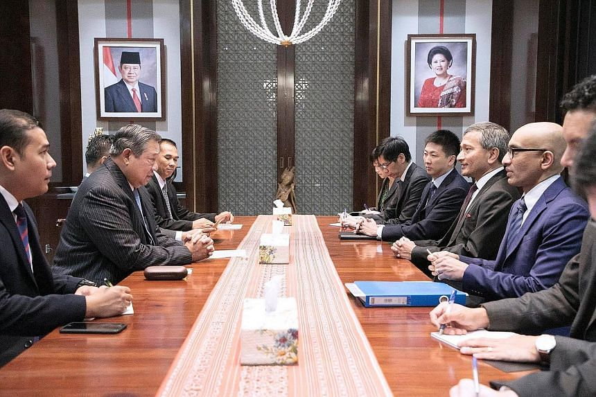Foreign Minister Vivian Balakrishnan meeting former Indonesian president Susilo Bambang Yudhoyono (second from left) at his residence in Jakarta yesterday.