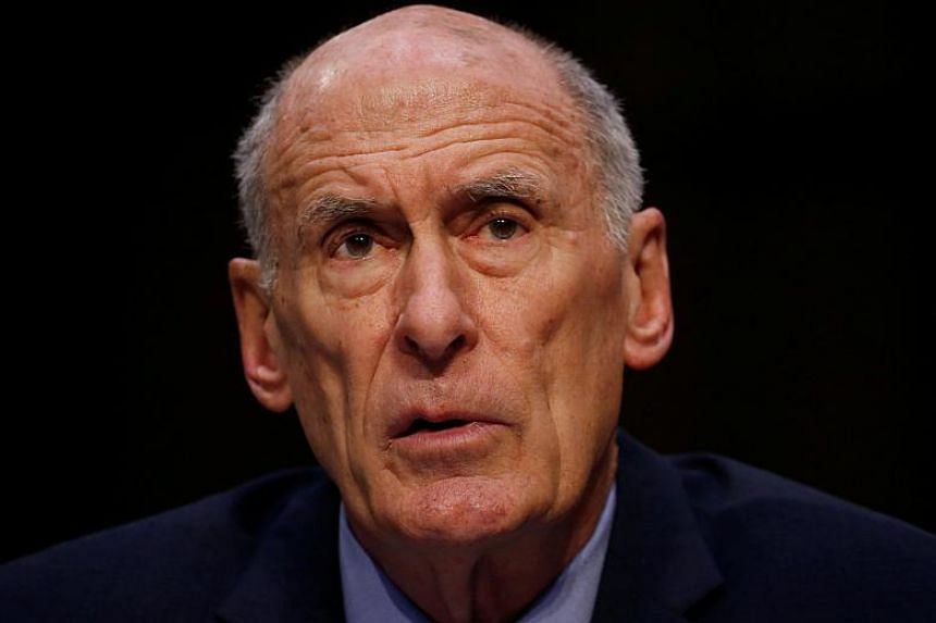 US director of national intelligence Dan Coats testifies during a Senate Intelligence Committee hearing on Worldwide Threats on Capitol Hill in Washington on Feb 13, 2018.