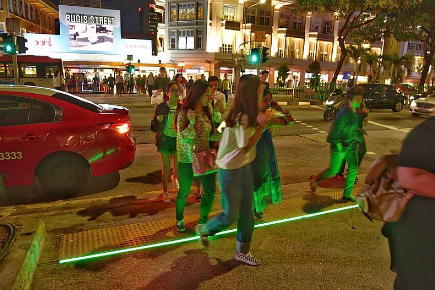 The LED strips were originally introduced in May last year at two locations - the junction of Buyong Road and Orchard Road, and the Victoria Street crossing outside Bugis Junction - as part of a six-month trial.