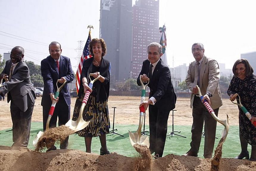 US Ambassador to Mexico Roberta Jacobson (third left), Mexican Secretary of Government Alfonso Navarrete (second left) and Mexico City's Chief of Government Miguel Angel Mancera (third right) participate in a ceremony to inaugurate the construction o
