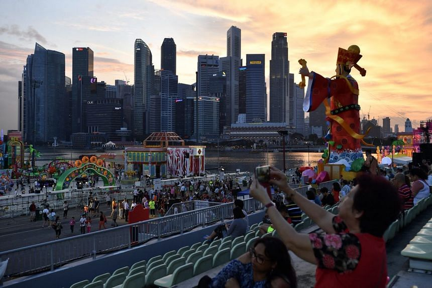God of Fortune against the CBD skyline during sunset at the launch of River Hongbao 2018.