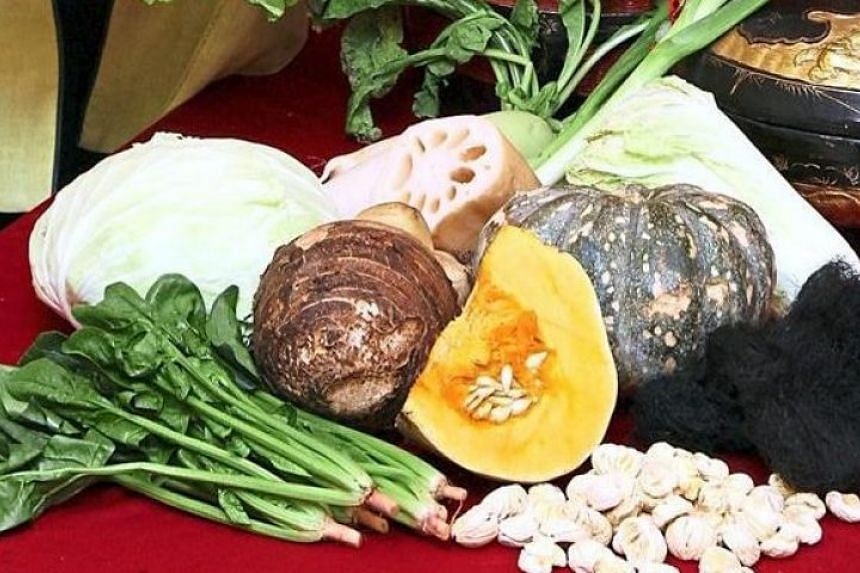 An assortment of greens and ingredients to cook a festive Chinese New Year meal.