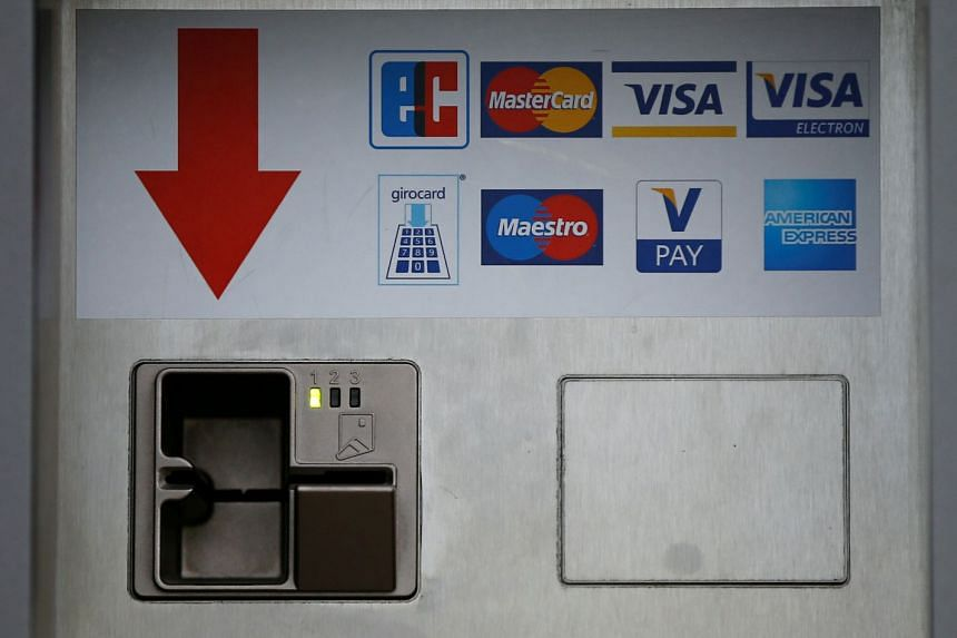 A card slot for various credit and payment cards is seen in Duesseldorf, Germany. Cash accounted for 47.6 per cent of transactions in Germany last year, the first time it has fallen under 50 per cent since recording beganin 2008, due mainly to an inc
