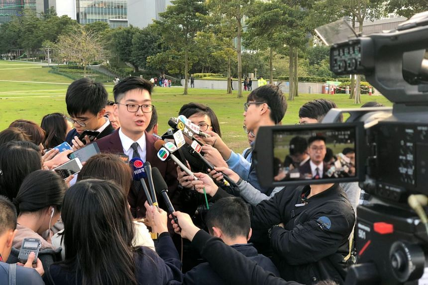 Hong Kong pro-independence activist Andy Chan speaking to members of the media after being barred from standing for election, on Feb 13, 2018.