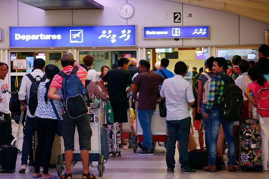 Tourists waiting in the departure hall at Velana International Airport in Male, Maldives, on Feb 13, 2018.