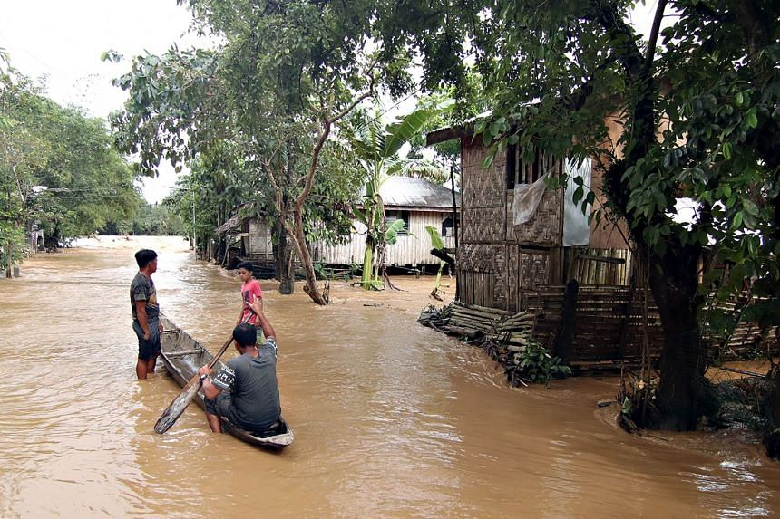 Residents using a canoe to survey their village after it was flooded following heavy rains brought about by Tropical Storm Sanba, in Jaboanga town in Mindanao, on Feb 13, 2018.