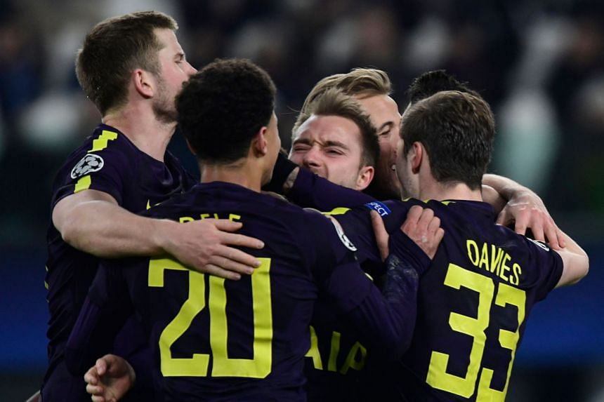 Eriksen (centre) celebrates with team mates after scoring his team's second goal.
