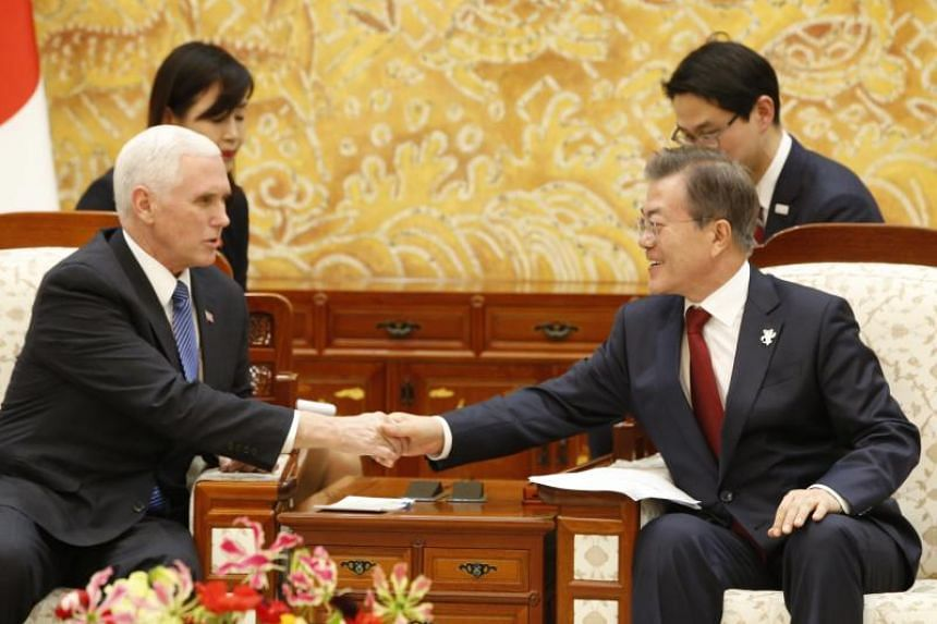 US Vice President Mike Pence (left) shakes hands with South Korean President Moon Jae In prior to their meeting at the presidential office Cheong Wa Dae (The Blue House) in Seoul, South Korea, on Feb 8, 2018.