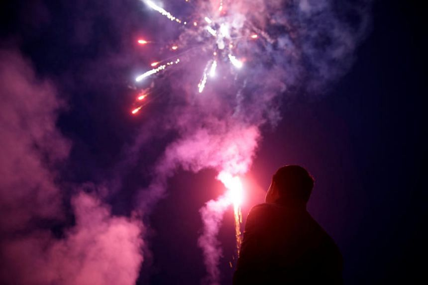 A worker watches fireworks at Liuyang Standard Fireworks Manufactory in Liuyang, Hunan province, China on Jan 29, 2018.