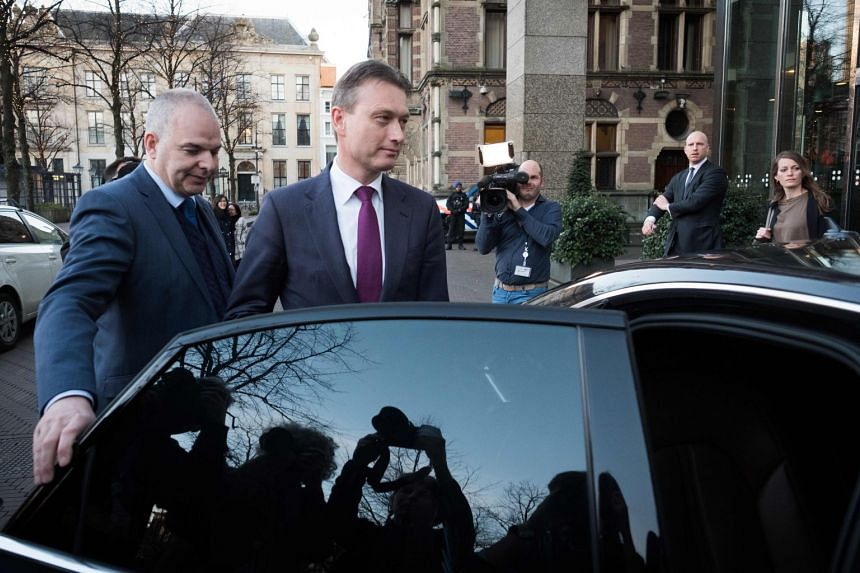 Zijlstra (centre) leaves the Dutch parliament after announcing his resignation.