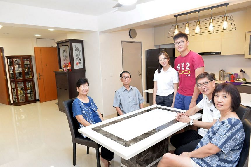 (From left)  Madam Lai Su Lan and Mr Wong Chong Hwee, with their grandchildren Wong Rou Xuan and Wong Jia Yi, and their son Wong Khai Beng, and daughter-in-law Ooi Guat Yian in their new Buangkok Crescent three-generation (3Gen) flat.