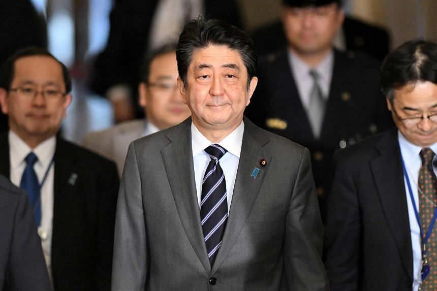 Japanese media reported that PM Shinzo Abe (pictured) took up the abductee issue and raised the topic of North Korea's nuclear and missile programmes with Kim Yong Nam.