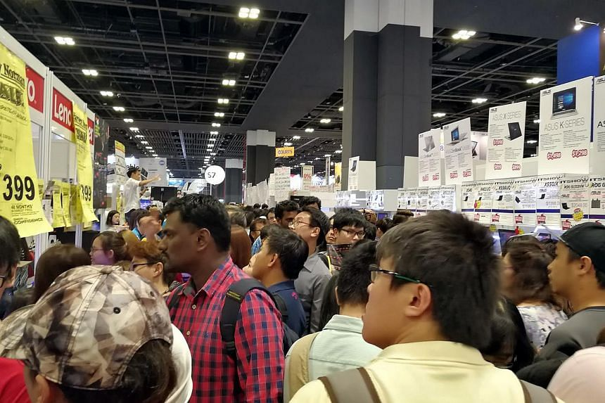 A crowd at an electronics exhibition in Singapore in a photo taken in 2015.