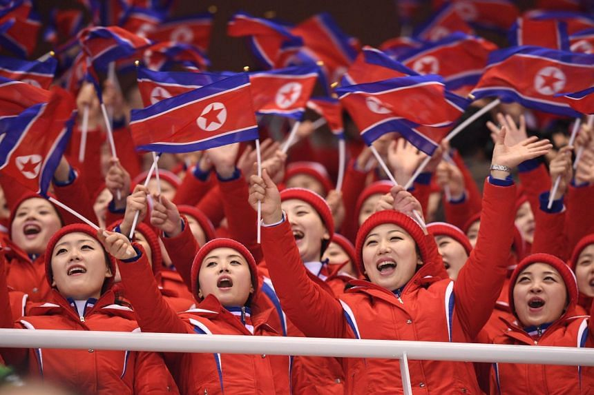 North Korean cheerleaders wave North Korea flags during the Pyeongchang 2018 Winter Olympic Games on Feb 14, 2018. The 200-strong group consists of women in their late teens or early 20s and said to be handpicked from elite universities after strict
