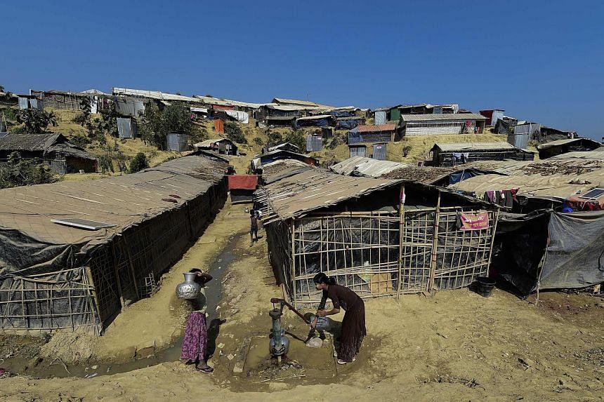 Rohingya Muslim refugees collect water at Thankhali refugee camp in Bangladesh's Ukhia district, on Jan 24, 2018.