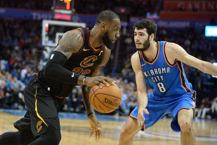 Cleveland Cavaliers forward LeBron James (left) driving against Oklahoma City Thunder guard Alex Abrines during their NBA match on Feb 13, 2018.