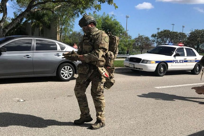 Swat and police are seen in Coral Springs after the shooting at Marjory Stoneman Douglas High School.