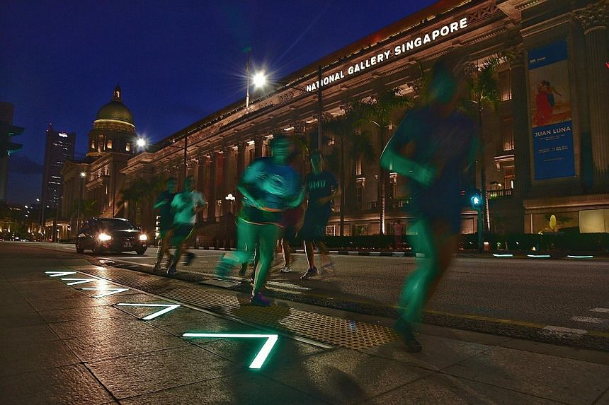 """At the St Andrew's Road crossing in front of the National Gallery Singapore, the LED strips have been redesigned with green arrows to be """"more intuitive"""" for pedestrians. The lights are aimed at ensuring all pedestrians, in particular those whose eye"""