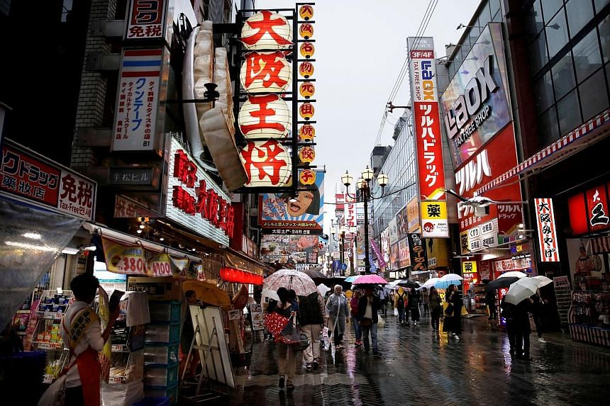 A shopping area in Osaka. Private consumption, which accounts for about two-thirds of Japan's gross domestic product, rose 0.5 per cent in the October-December quarter. Exports rose 2.4 per cent, but this was offset by a 2.9 per cent jump in imports