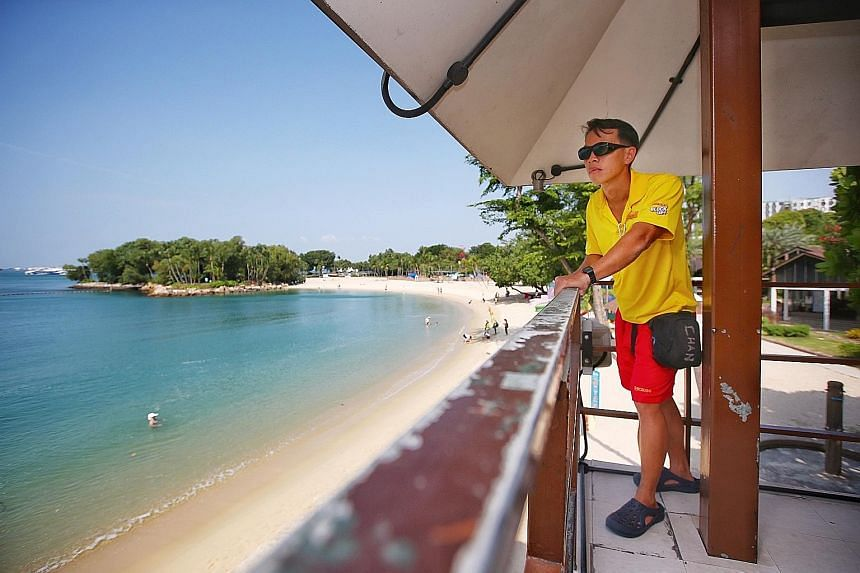 Mr Chan Tak Mun at a lookout tower in Palawan Beach. The 38-year-old will be among about 20 beach patrol officers helping to keep Sentosa's waters safe for swimmers during Chinese New Year, one of the island's busiest periods.
