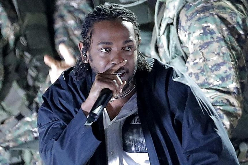 Compton rapper Kendrick Lamar puts himself in the shoes of T'Challa, the superhero/king of fictional African nation Wakanda, in the album opener and title track.