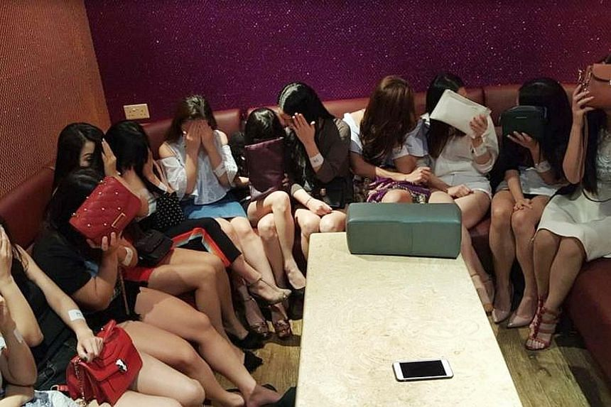Some of the women who were arrested for working without a licence at a public entertainment outlet. The police said that action will also be taken against the outlet's operator for contravening licensing conditions.