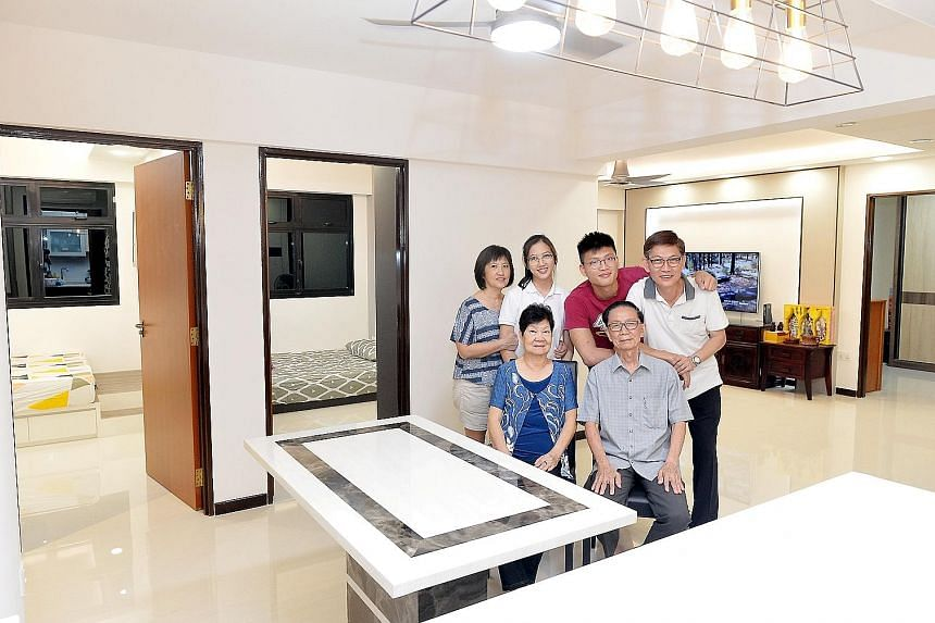Mr Wong Khai Beng (standing, far right), 55, with his parents - Mr Wong Chong Hwee, 83, and Madam Lai Su Lan, 77, - his wife, Madam Ooi Guat Yian, 55, and their children - Rou Xuan (standing second from left), 19, and Jia Yi, 22 - in their new three-