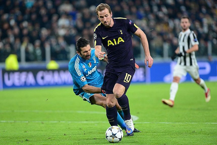 Tottenham's Harry Kane scores his first goal after evading Juventus' veteran goalkeeper Gianluigi Buffon. After conceding two goals in the first nine minutes of their Champions League encounter, Spurs fought back with goals from Kane and Christian Er