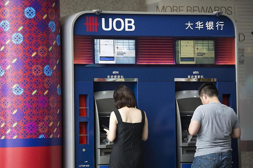 UOB's fourth-quarter net earnings rose 16 per cent to $855 million from a year ago.