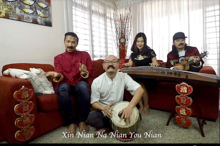 A screen grab of the video showing four Malaysians performing a classic Chinese New Year song with a multicultural twist. Netizens commended the video for its creativity.