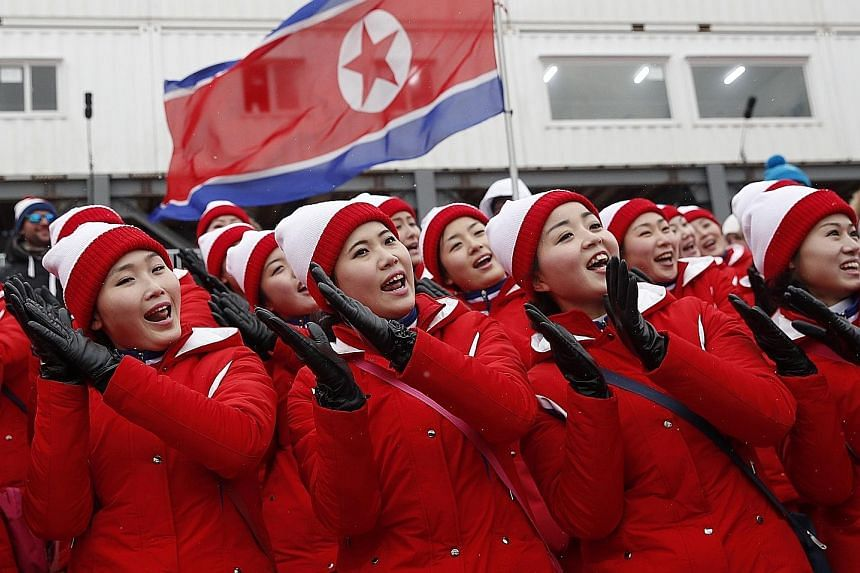 North Korean cheerleaders at the Yongpyong Alpine Centre in Pyeongchang yesterday. Seoul will pay for costs, including food and lodging, for the North's cheering squad, orchestra, taekwondo performers, journalists and other supporting personnel.