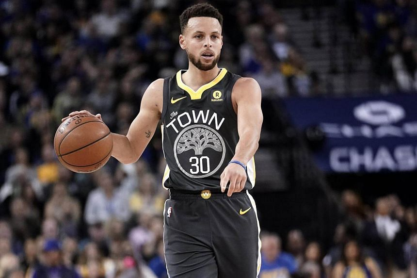 Golden State Warriors guard Stephen Curry sets up for a play against the San Antonio Spurs during the first half of their NBA game at the Oracle Arena in Oakland, on Feb 10, 2018.