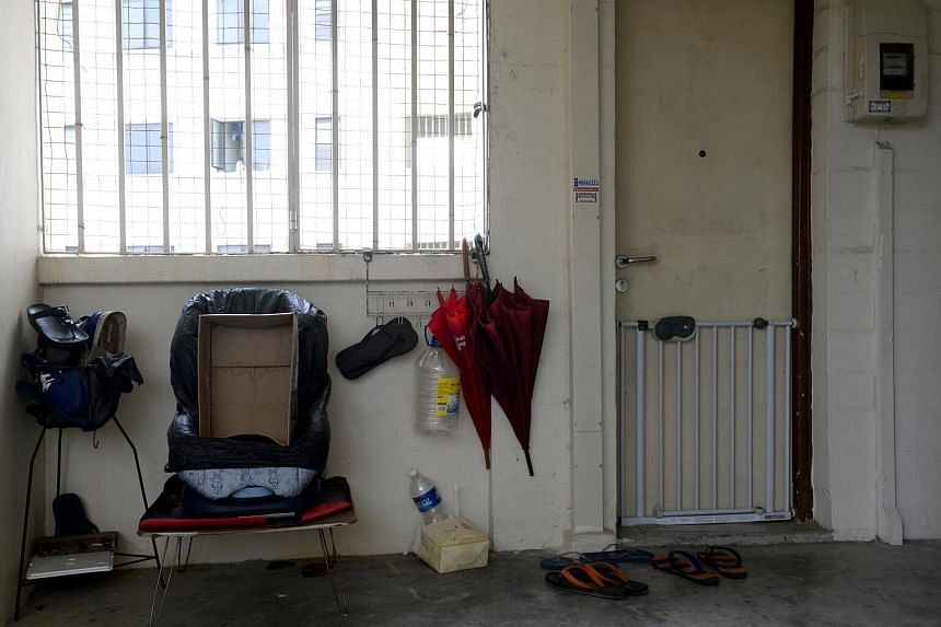 Objects are seen outside the Dakota Crescent apartment unit registered under Singaporean company Black Tidings, on May 21, 2016. The president of Black Tidings, Tan Tong Han, was charged in court on Feb 15, 2018.