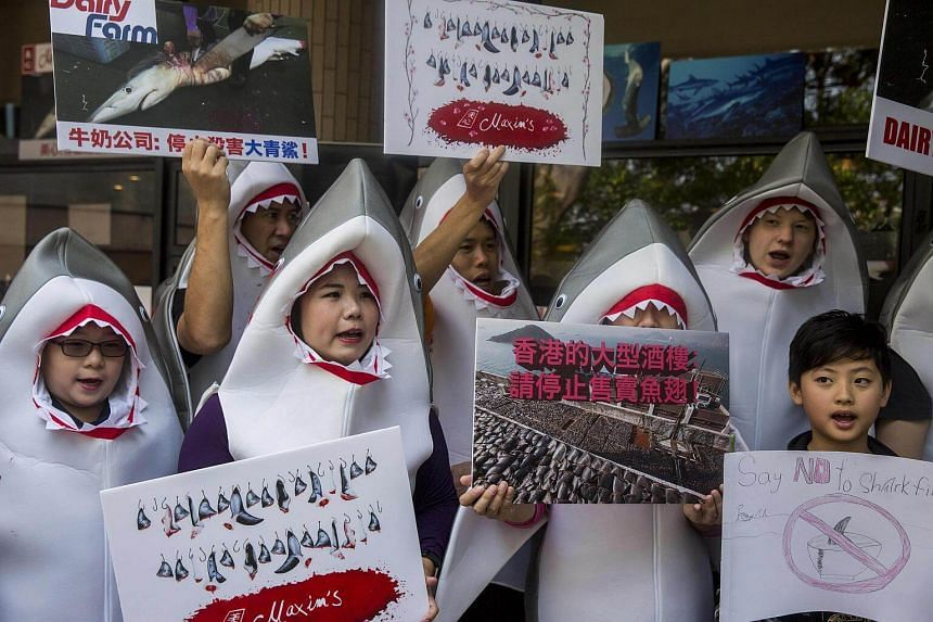 Shark fin activists protesting outside a Maxim's restaurant in Hong Kong over the group's continued sale of shark fin, on Feb 10, 2018.