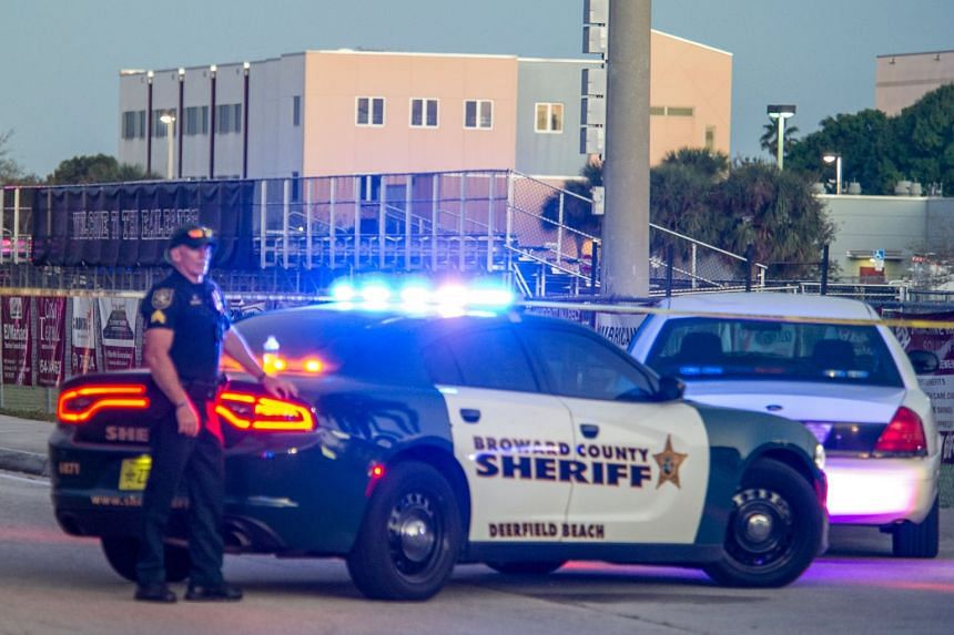 Law enforcement officers standing guard near Marjory Stoneman Douglas High School after a shooting, on Feb 14, 2018.