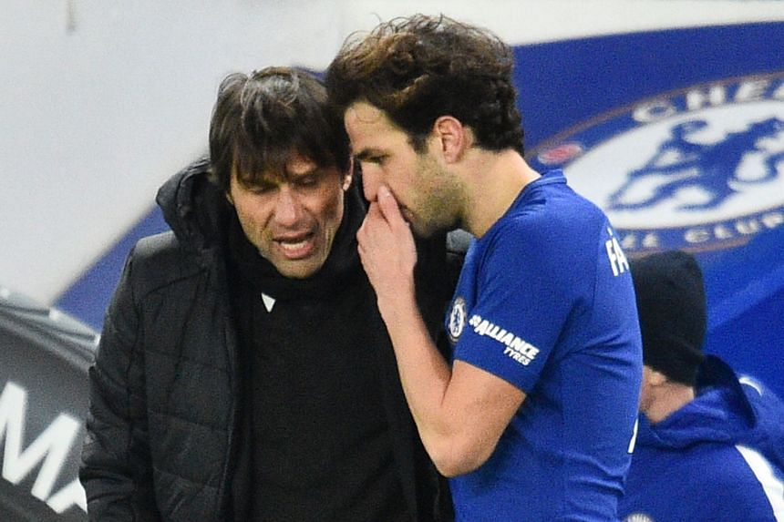 Conte talking with Chelsea midfielder Cesc Fabregas during the match against West Bromwich Albion on Feb 12, 2018.